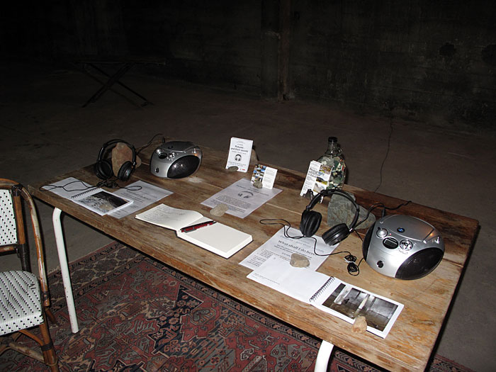 "Djúpavík. Exhibition ""Pictures - and their sounds"" in the old herring factory. - CD-Player, photography books and several informations on a table... (20 June 2010)"