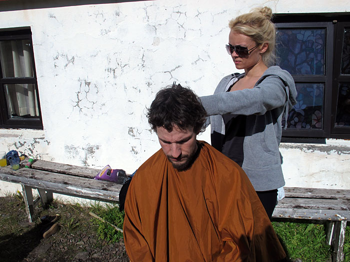 Djúpavík. The yearly visit at the haircutter (in Djúpavík). - Open Air hair cutting. By Kidda. (This picture was taken by Álfheiður!). (9 August 2011)